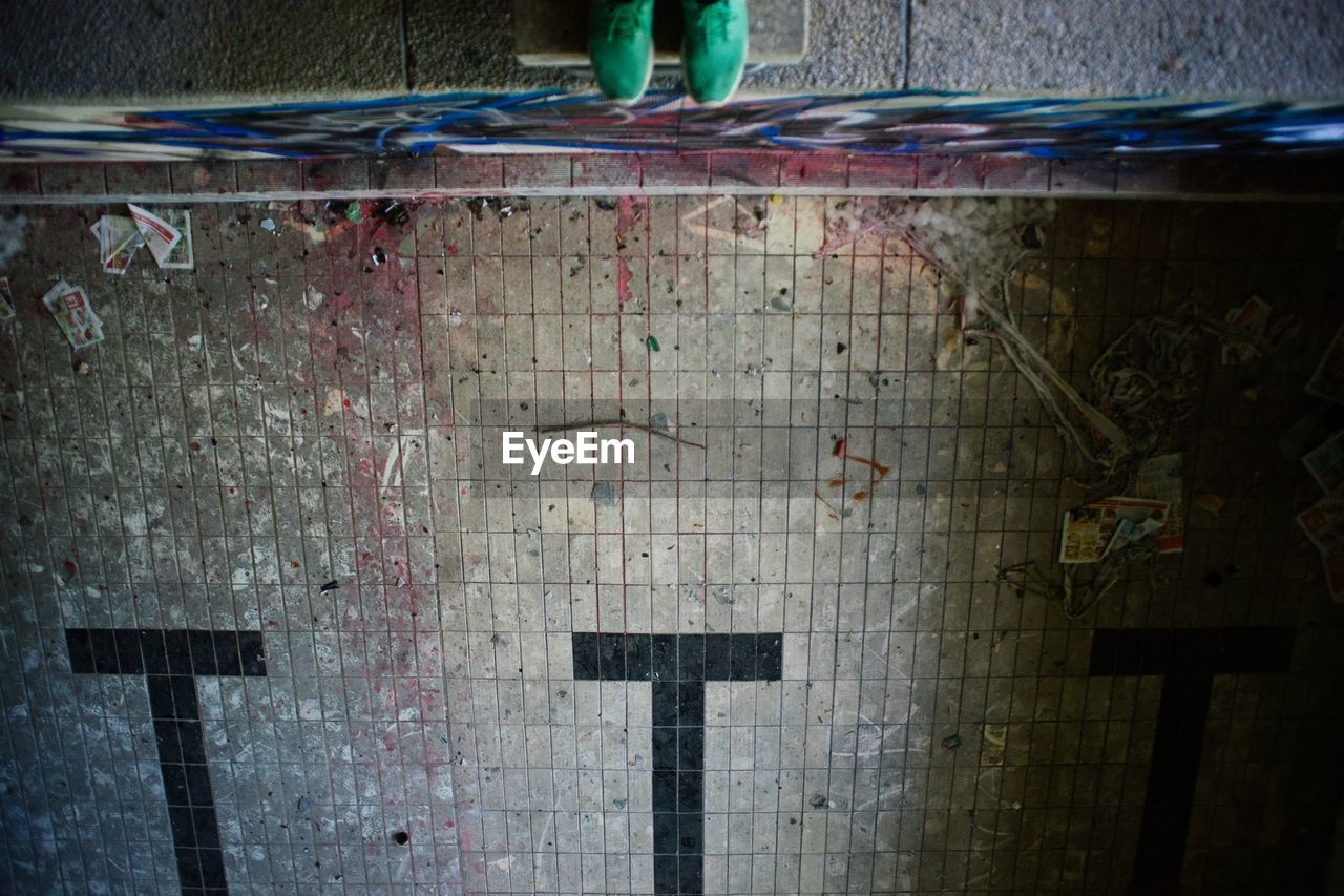 High angle view of messy tiled floor