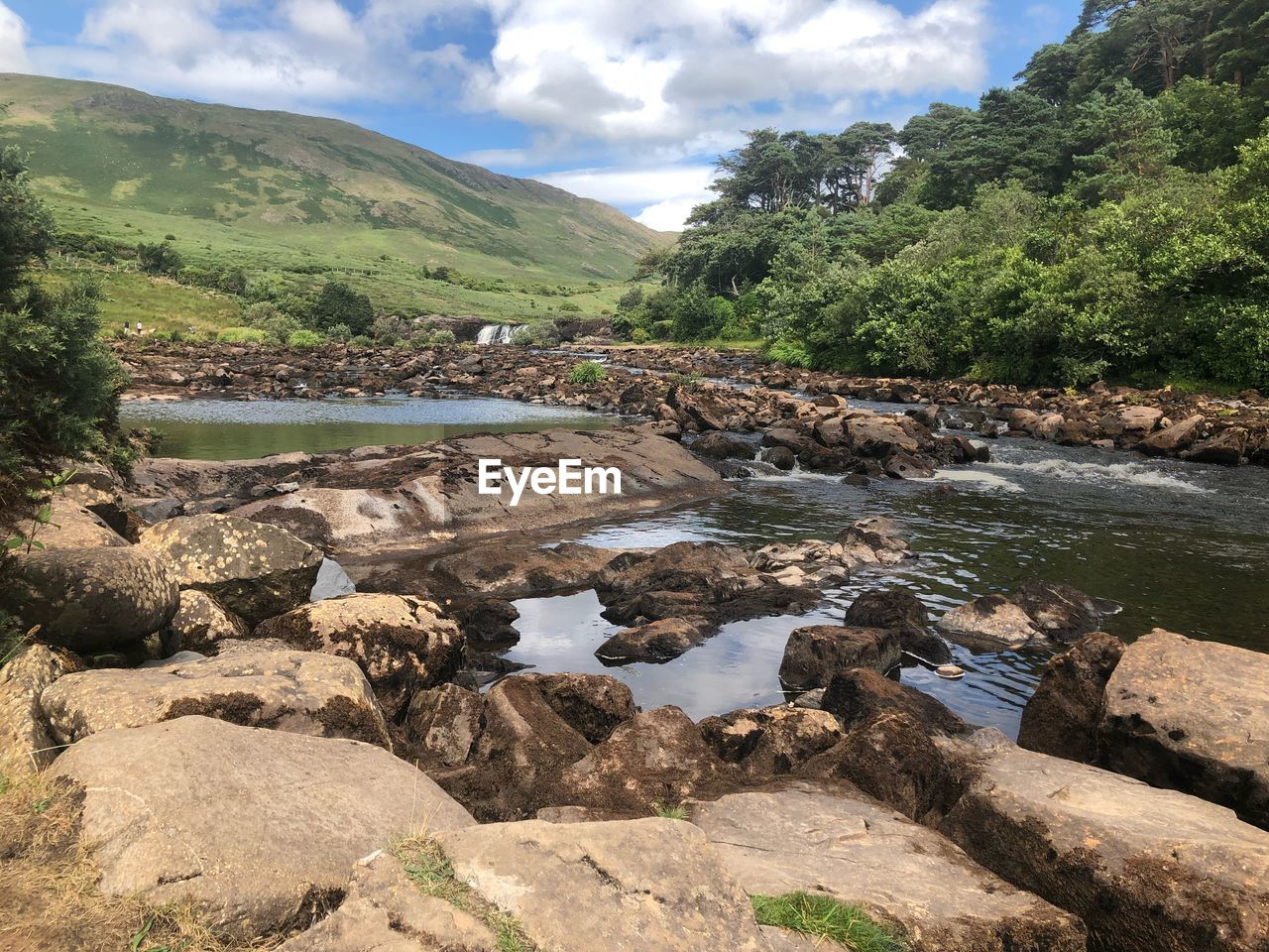 water, rock, beauty in nature, nature, sky, cloud - sky, rock - object, solid, environment, scenics - nature, tree, day, tranquility, river, tranquil scene, land, landscape, no people, mountain, outdoors, flowing water, flowing