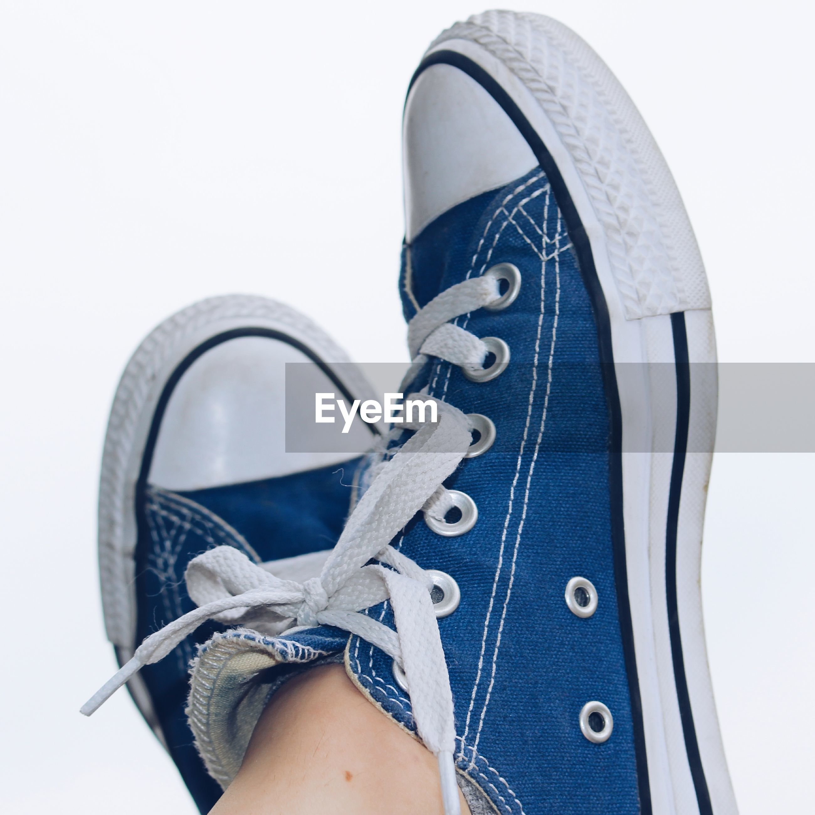 person, shoe, personal perspective, low section, lifestyles, part of, men, close-up, denim, canvas shoe, wristwatch, human foot, studio shot