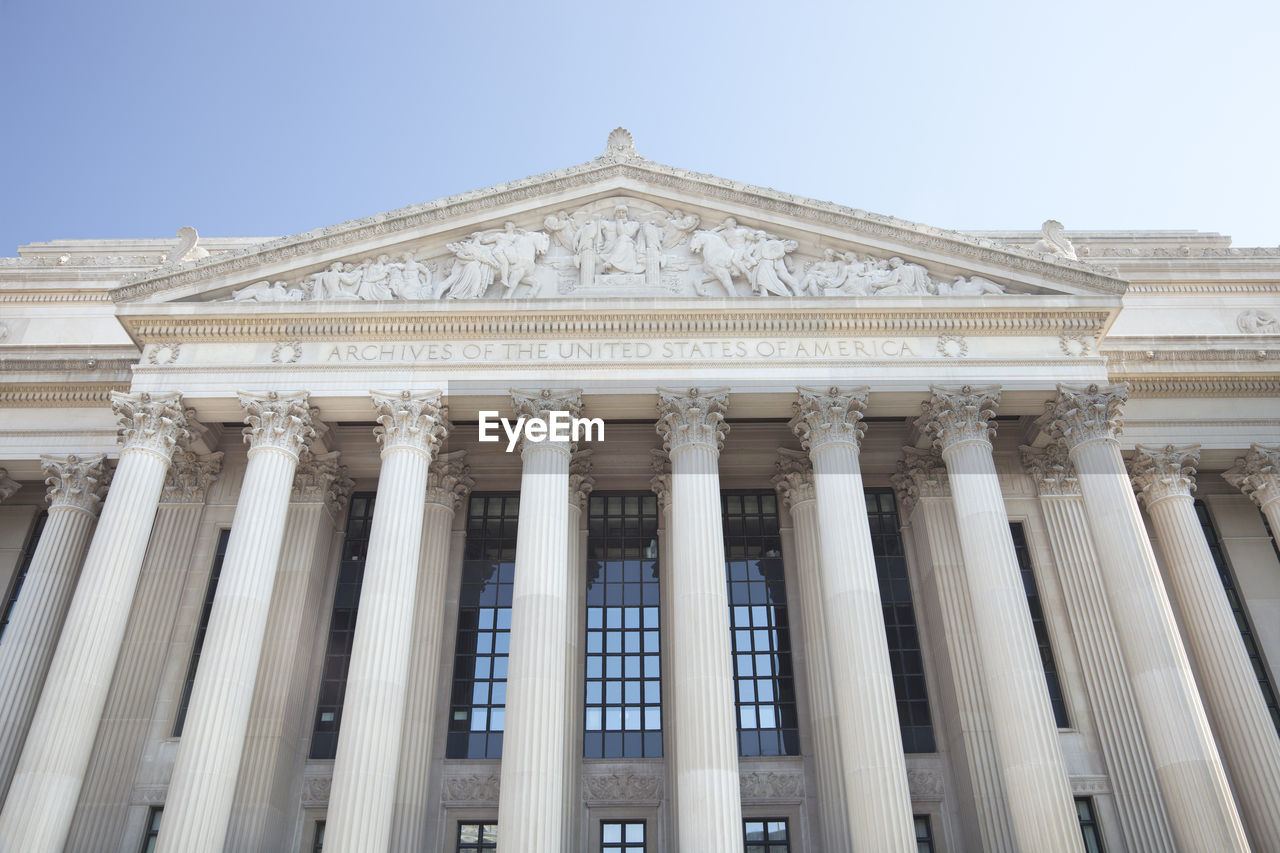 Low angle view of national archives building against clear sky in city