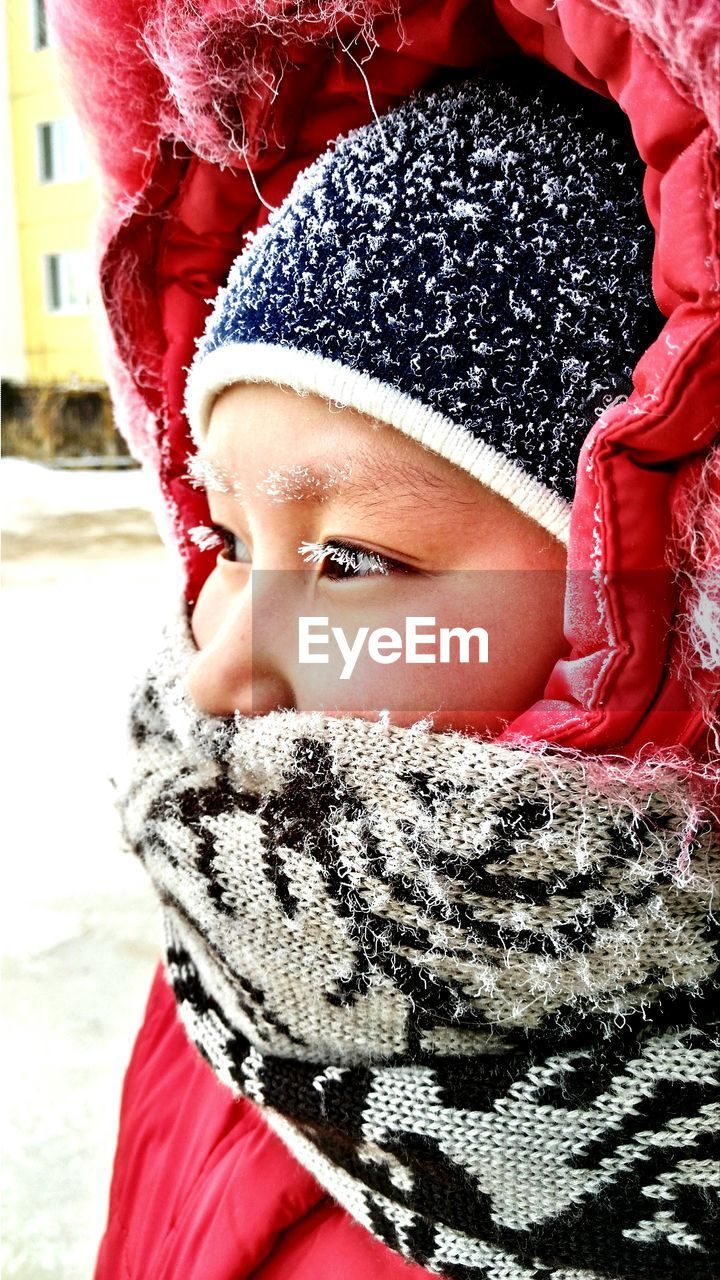 winter, cold temperature, warm clothing, snow, knit hat, childhood, scarf, red, real people, one person, cute, looking at camera, portrait, leisure activity, day, outdoors, close-up, lifestyles, snowflake, nature, people