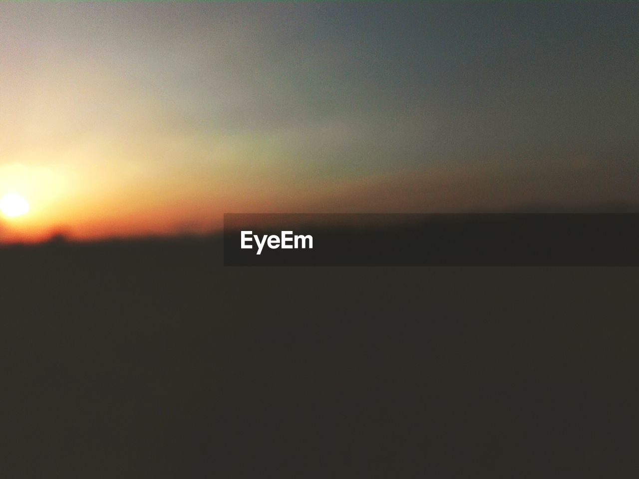 sunset, sky, tranquility, beauty in nature, scenics - nature, tranquil scene, silhouette, nature, orange color, landscape, environment, copy space, sun, no people, outdoors, idyllic, cloud - sky, non-urban scene, horizon, dusk