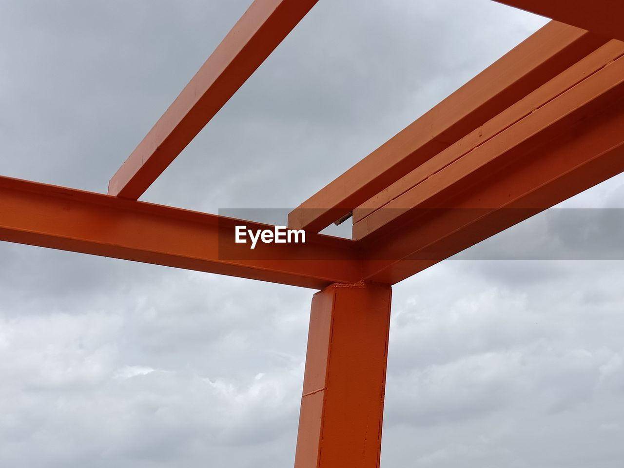 cloud - sky, sky, low angle view, built structure, architecture, no people, day, nature, outdoors, metal, orange color, bridge, red, connection, bridge - man made structure, close-up, transparent