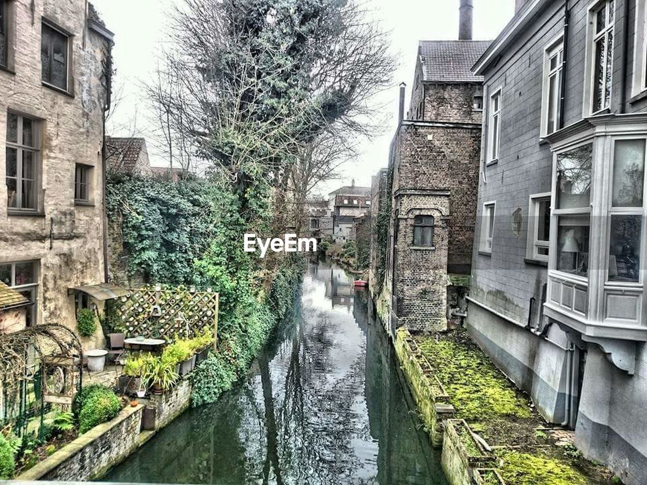 building exterior, architecture, built structure, water, motion, outdoors, day, tree, no people, house, water wheel, watermill, waterfall, bare tree, nature, city, sky