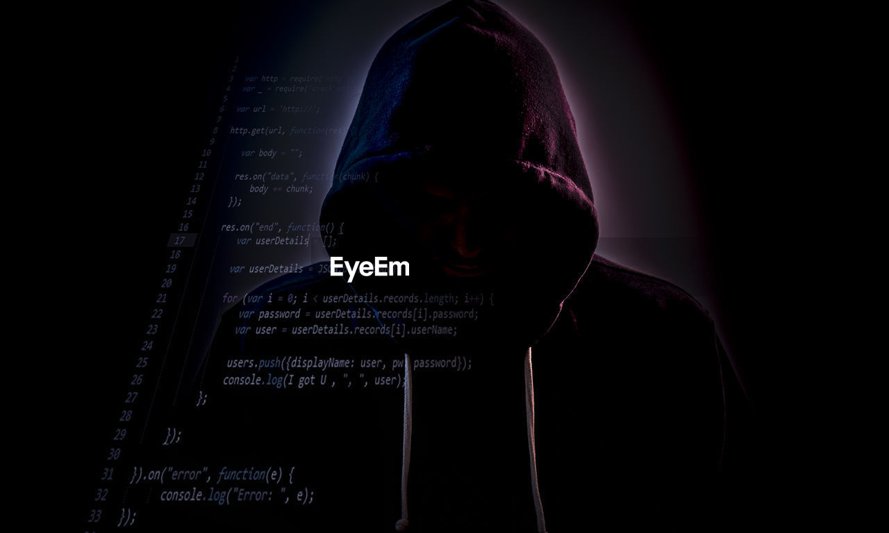 one person, data, real people, studio shot, communication, night, hooded shirt, men, indoors, headshot, binary code, technology, illuminated, cyberspace, black background, close-up, young adult, adult, people