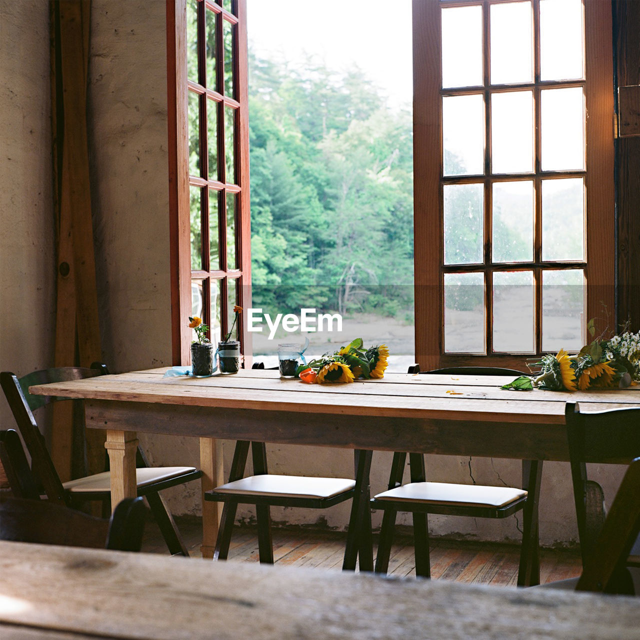 View Of Chairs At Dining Table By The Window