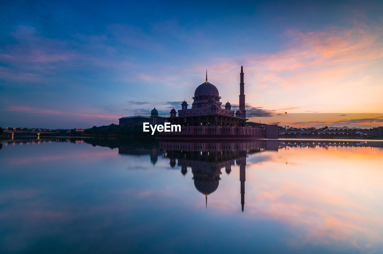 Reflection of putra mosque on lake during sunset