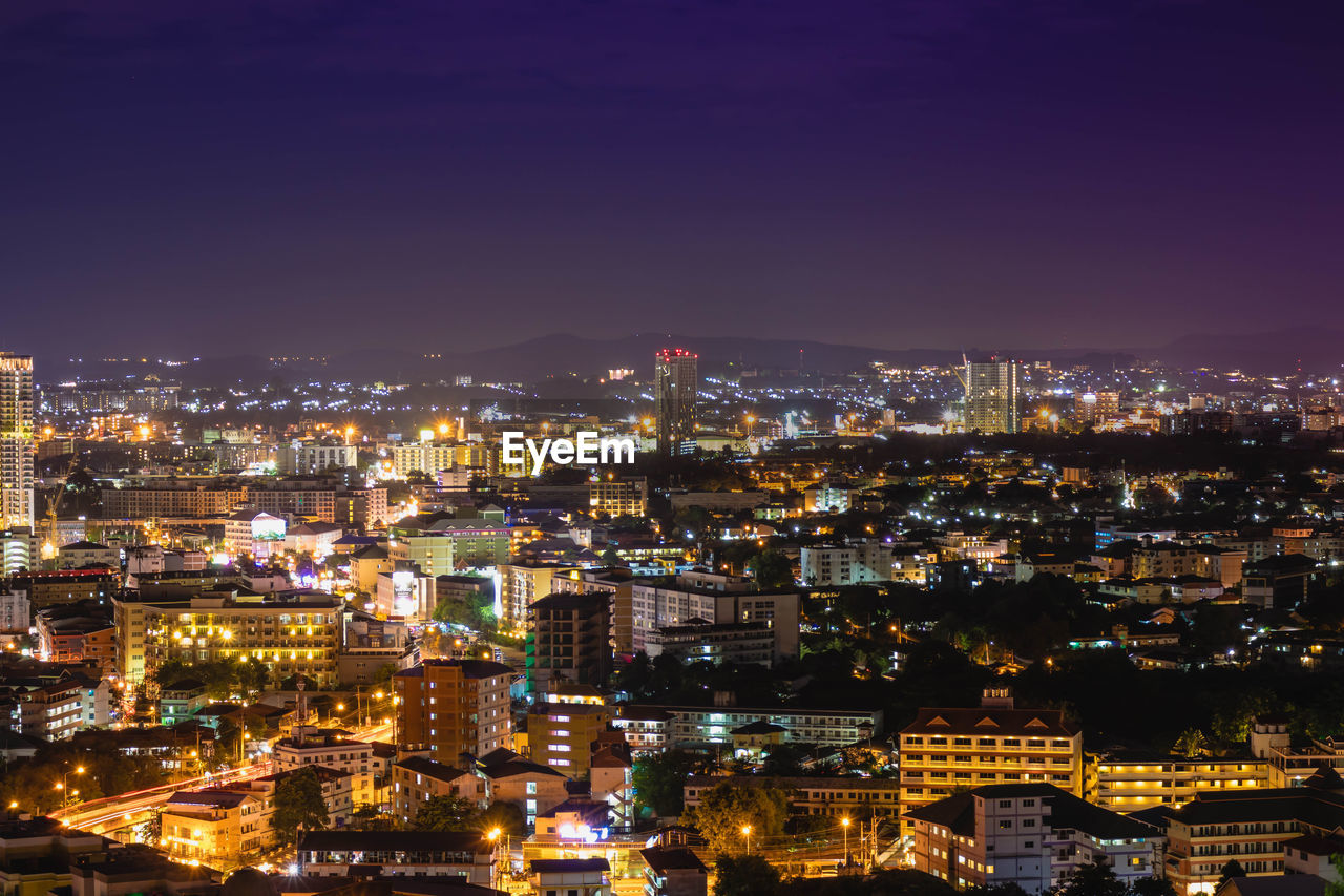 building exterior, architecture, cityscape, illuminated, city, built structure, night, high angle view, crowded, crowd, building, sky, residential district, nature, city life, outdoors, community, aerial view, office building exterior, skyscraper, settlement