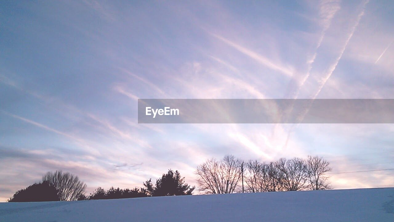snow, winter, cold temperature, nature, beauty in nature, scenics, weather, bare tree, tranquil scene, tree, sky, no people, outdoors, landscape, tranquility, cloud - sky, day, sunset