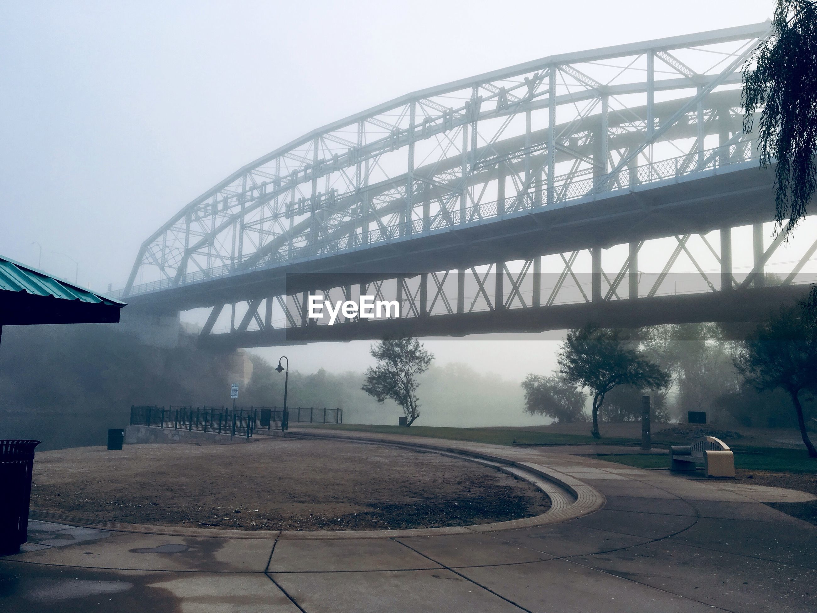 architecture, built structure, fog, tree, connection, plant, sky, nature, bridge, transportation, bridge - man made structure, water, day, no people, outdoors, building exterior, river