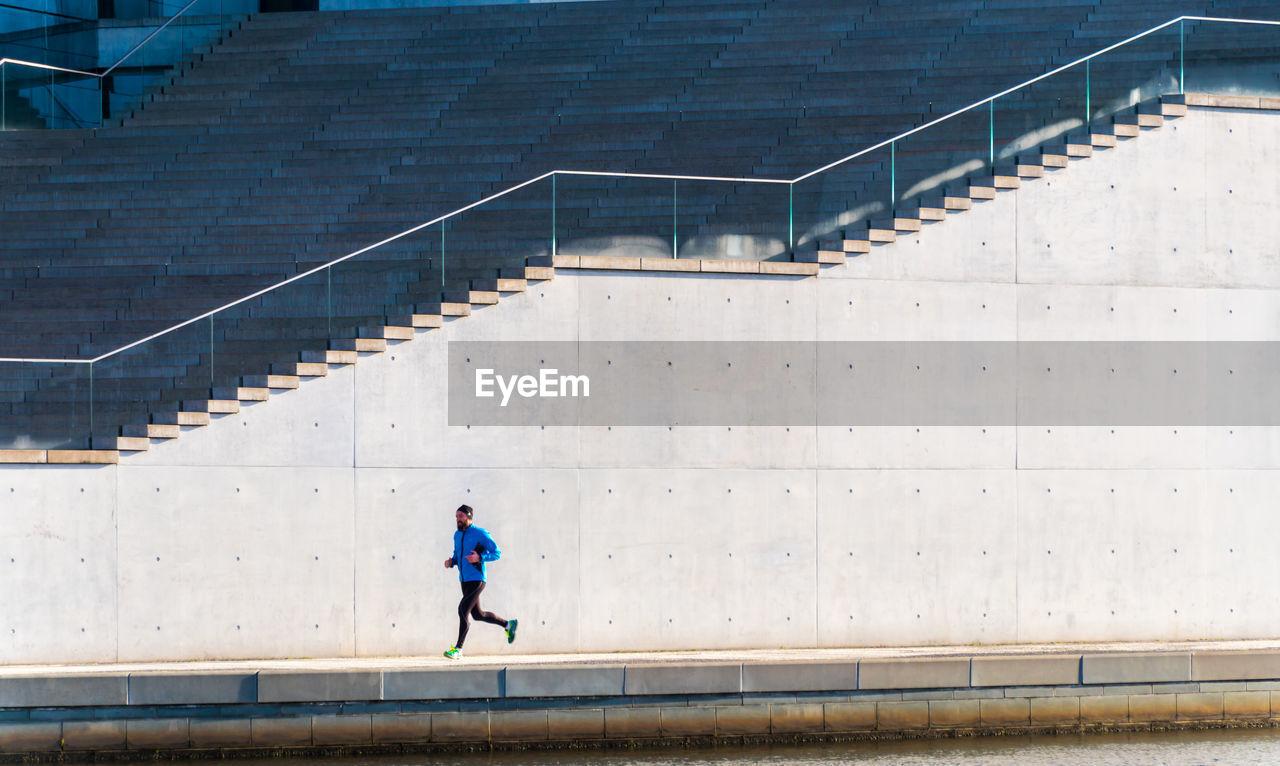 Man Jogging Against Steps