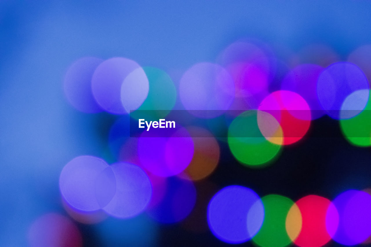 illuminated, defocused, light effect, circle, night, lighting equipment, glowing, no people, backgrounds, multi colored, celebration, outdoors, close-up, disco lights, projection equipment