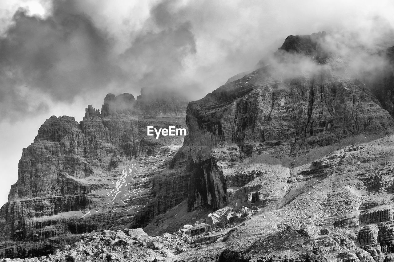 scenics - nature, cloud - sky, sky, mountain, beauty in nature, rock formation, tranquil scene, tranquility, non-urban scene, rock, physical geography, nature, geology, no people, environment, travel destinations, day, mountain range, solid, land, formation, outdoors, mountain peak, eroded