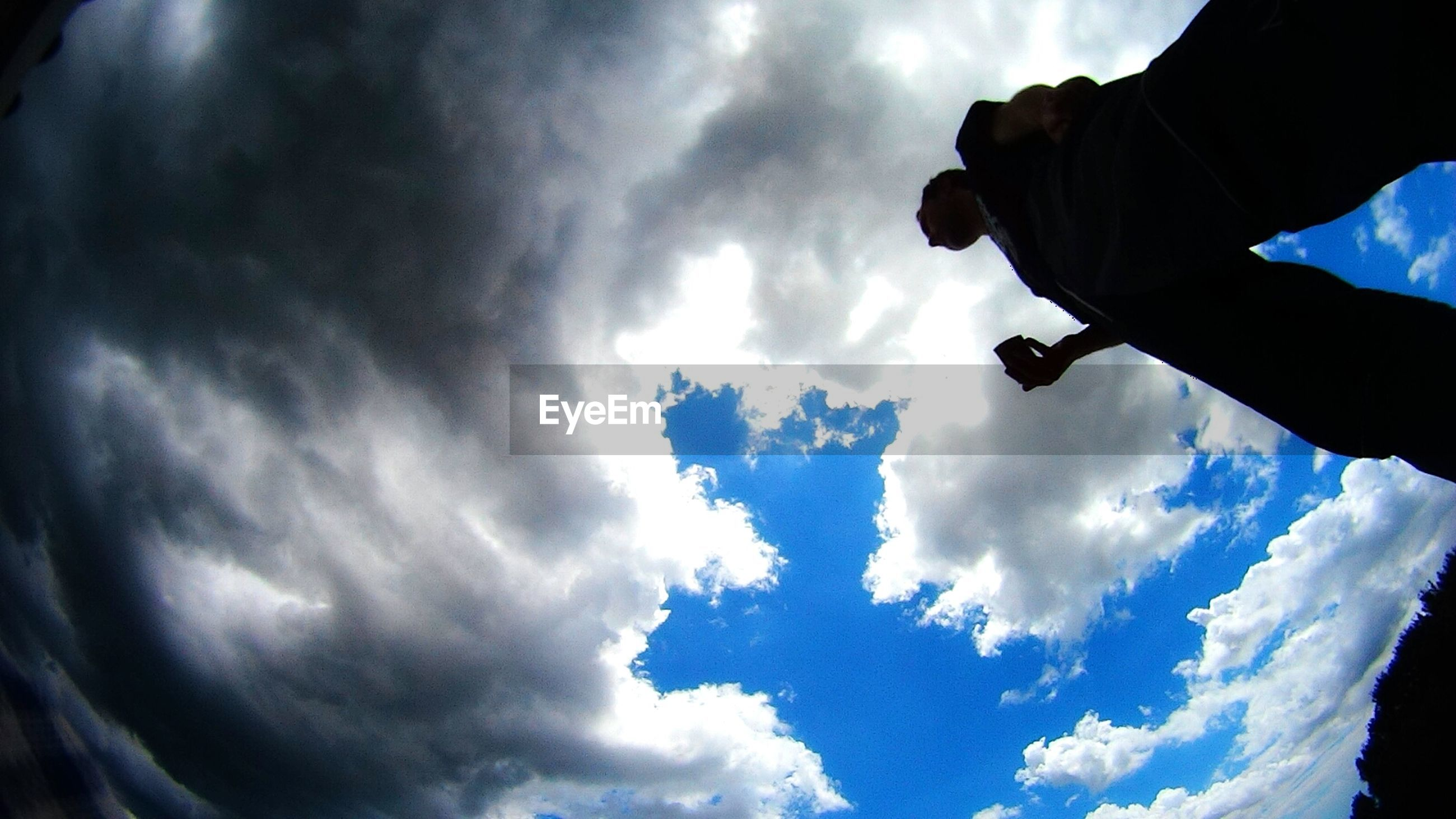 sky, cloud - sky, lifestyles, low angle view, men, leisure activity, cloudy, cloud, silhouette, standing, nature, cloudscape, scenics, beauty in nature, tranquility, person, tranquil scene