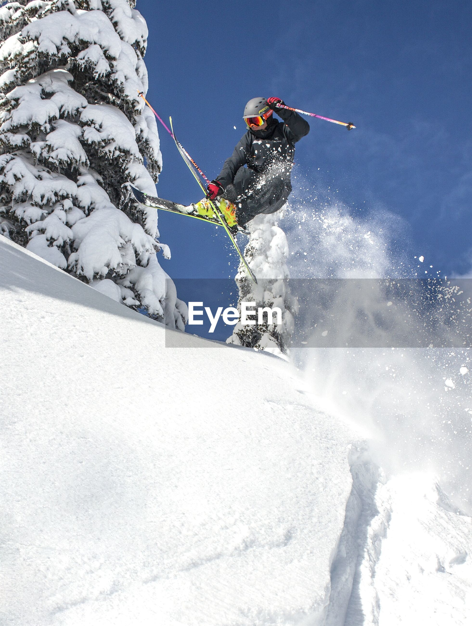 HIGH ANGLE VIEW OF PERSON ON SNOW