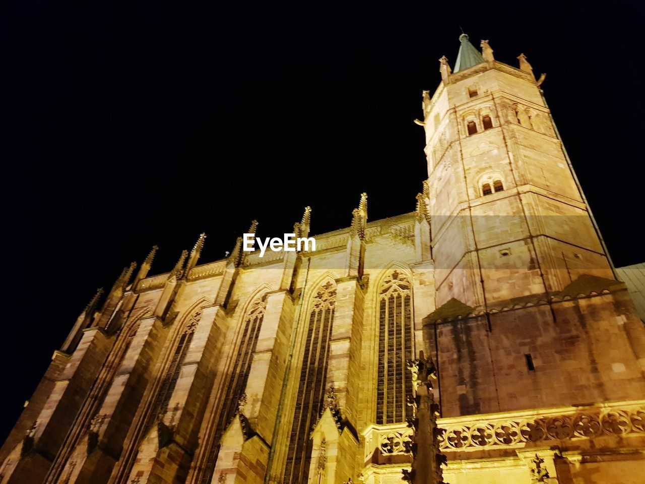 built structure, building exterior, architecture, night, low angle view, building, sky, no people, the past, history, travel, travel destinations, illuminated, tourism, place of worship, nature, belief, tower, religion, city, ancient civilization, gothic style, archaeology