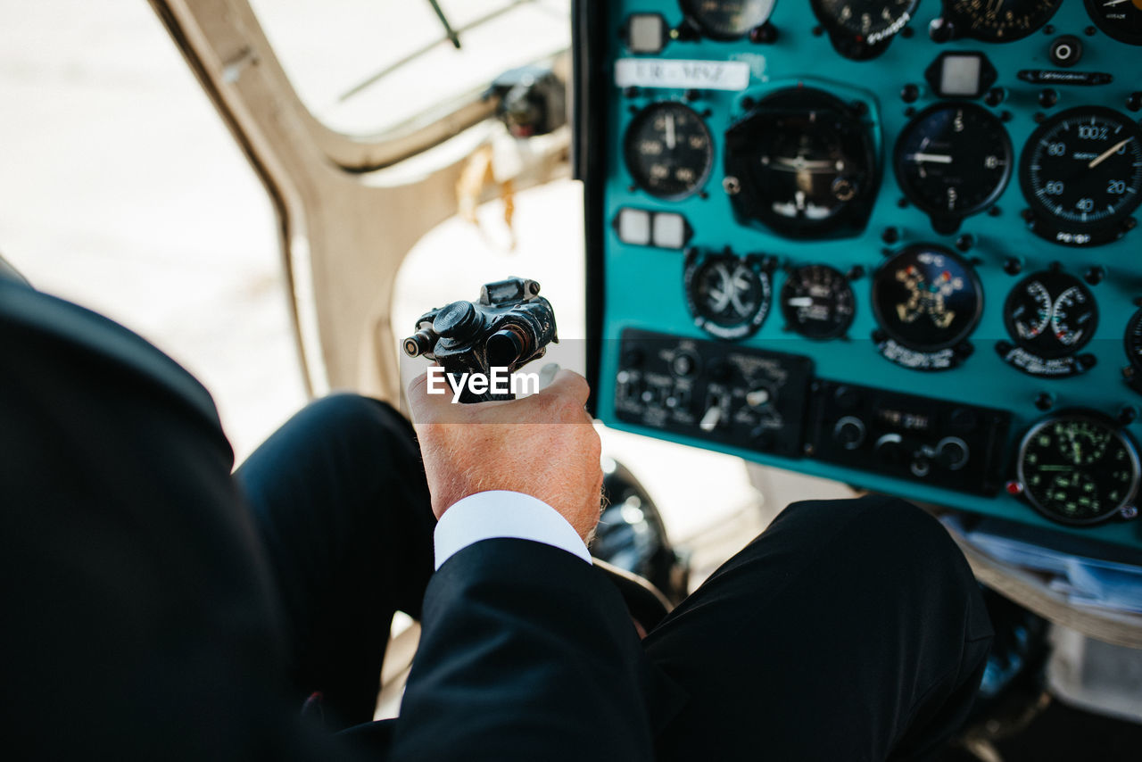 High angle view of pilot controlling helicopter