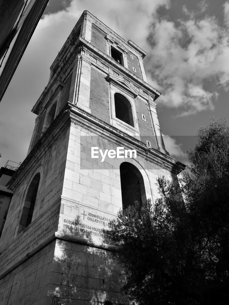 low angle view, sky, architecture, cloud - sky, building exterior, religion, built structure, no people, history, outdoors, place of worship, spirituality, tree, day