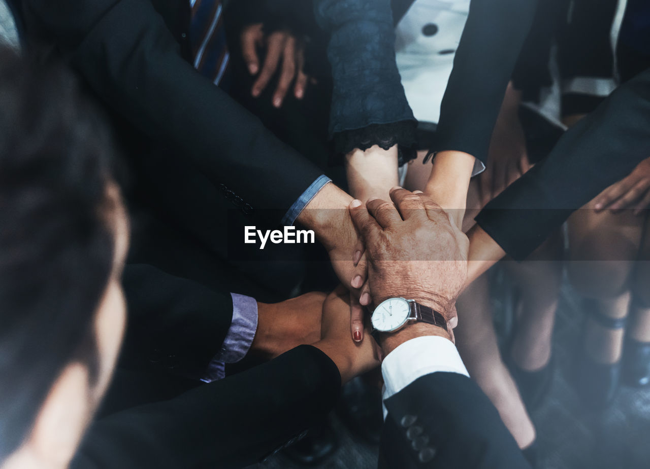 group of people, human hand, hand, real people, human body part, medium group of people, group, men, togetherness, cooperation, adult, teamwork, women, body part, high angle view, people, lifestyles, bonding, selective focus, unity, finger, human limb