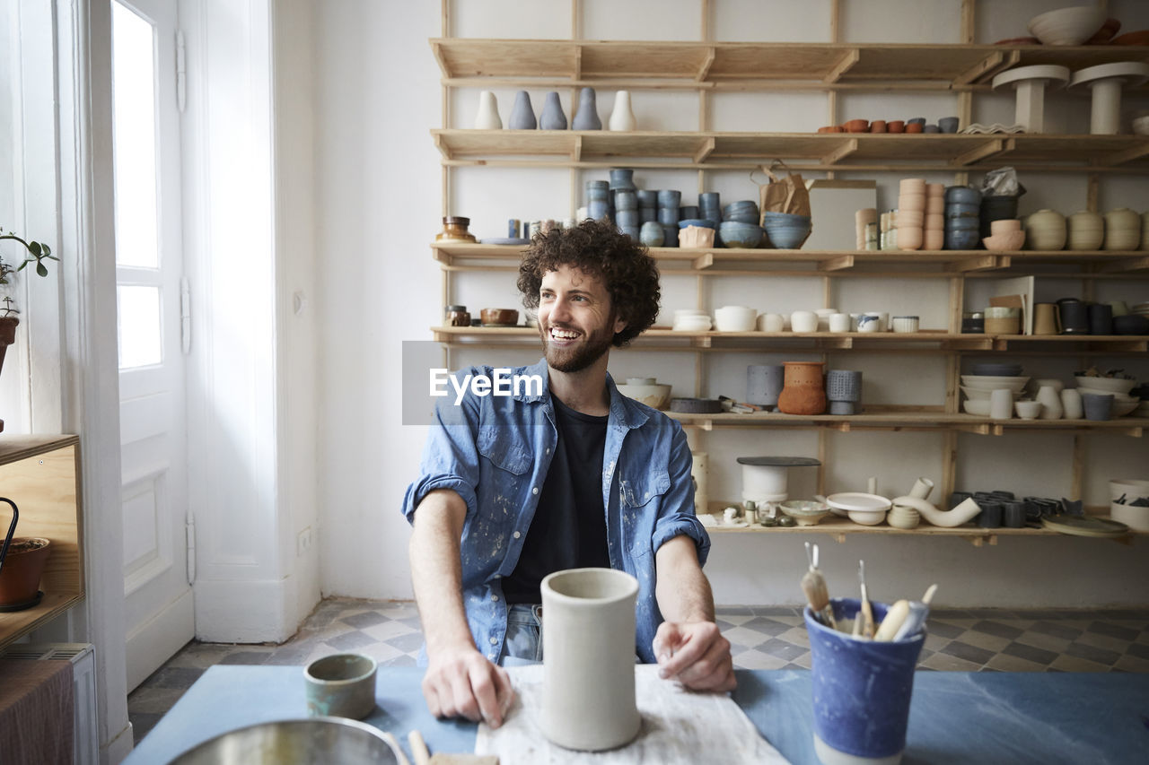 YOUNG MAN SITTING IN COFFEE AT HOME