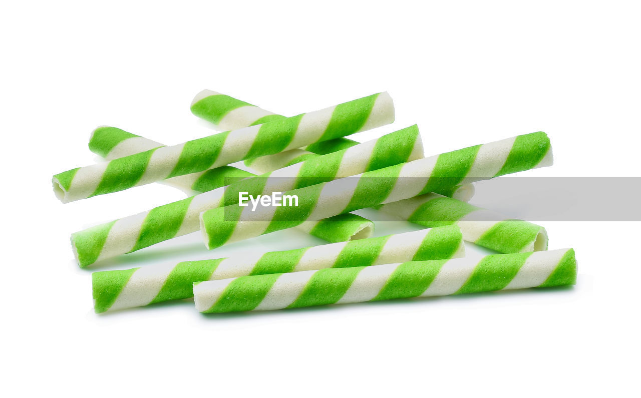 Close-up of chocolate sticks against white background