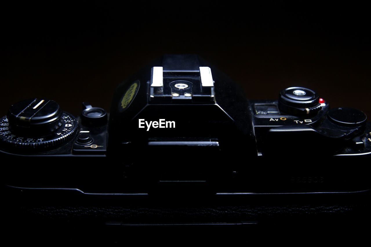 Close-Up Of Camera Against Black Background