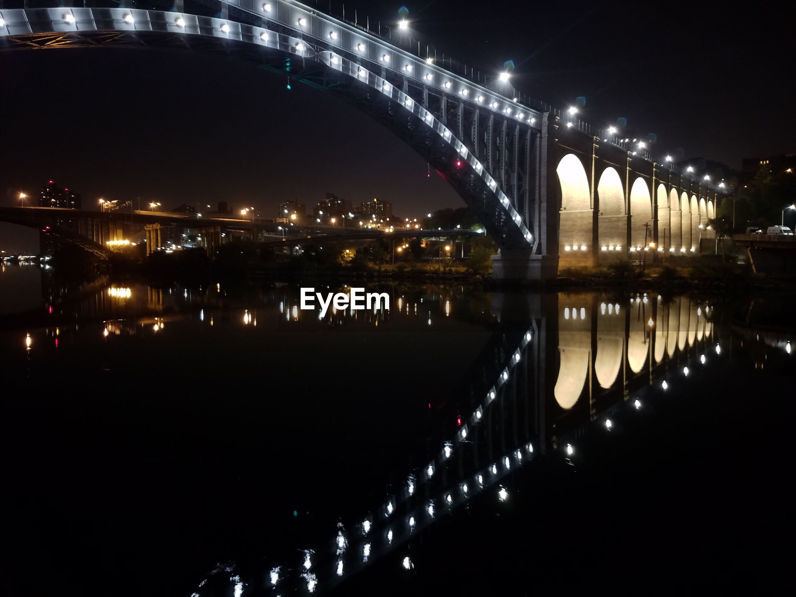 connection, architecture, bridge - man made structure, built structure, illuminated, night, water, engineering, reflection, river, transportation, bridge, building exterior, sky, waterfront, outdoors, scenics, tranquility, suspension bridge, water surface, tourism, no people