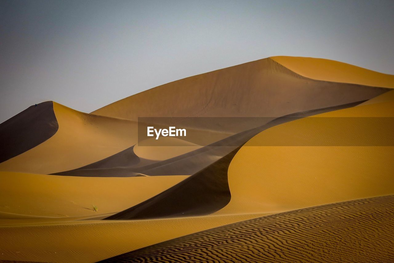 Low Angle View Of Desert Against Clear Sky