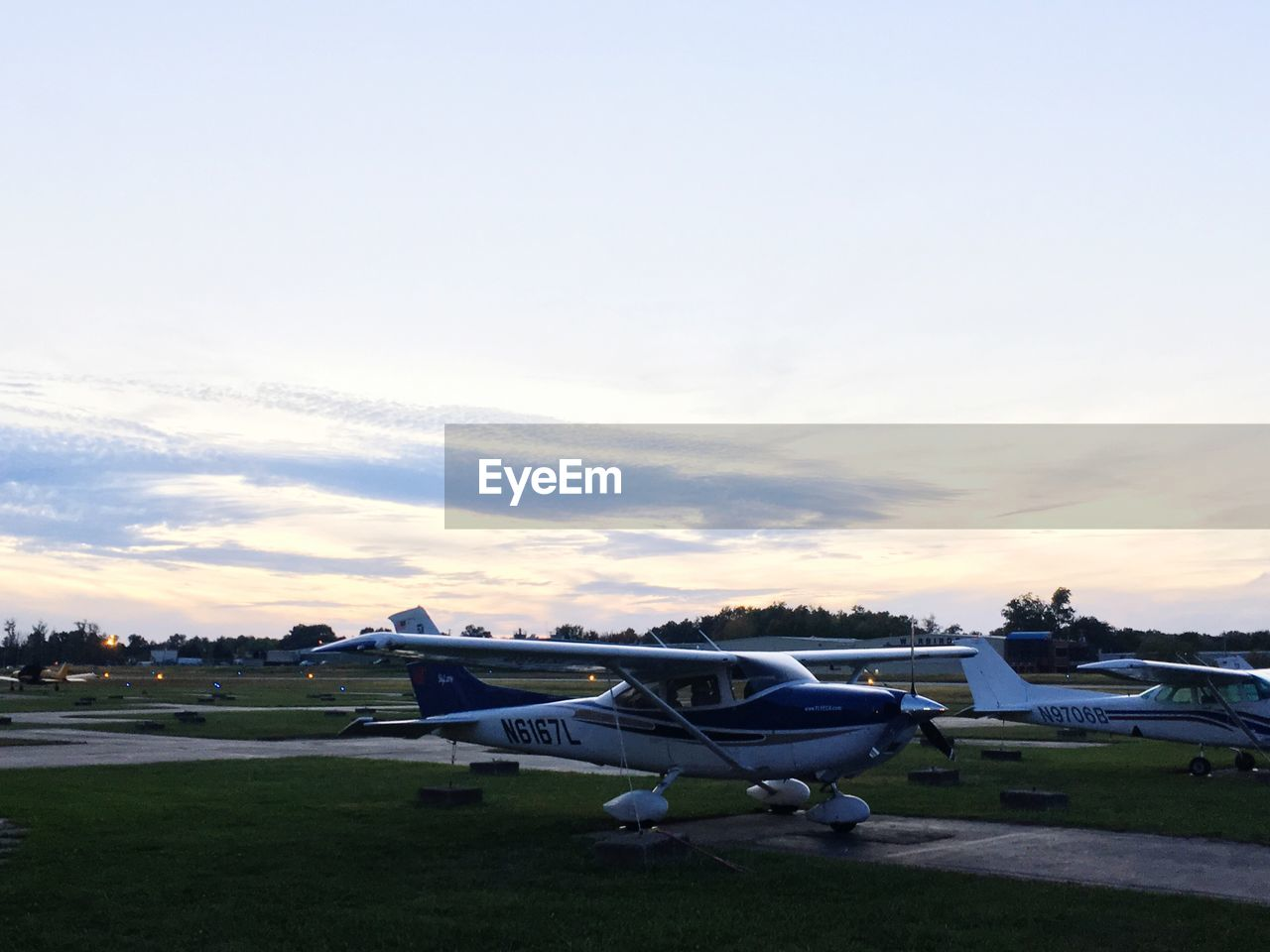 sky, sunset, cloud - sky, airplane, field, outdoors, no people, nature, transportation, air vehicle, landscape, scenics, grass, beauty in nature, day