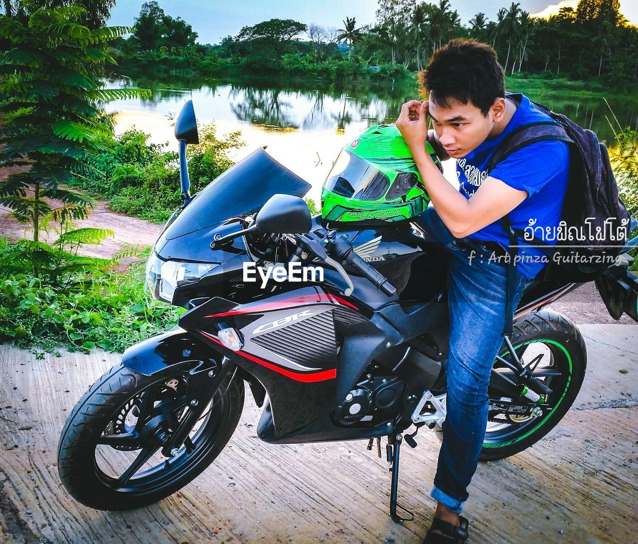 boys, real people, childhood, one person, bicycle, casual clothing, full length, transportation, leisure activity, lifestyles, mode of transport, land vehicle, looking at camera, elementary age, outdoors, riding, portrait, day, happiness, smiling, cycling helmet, tree, biker, young adult, people