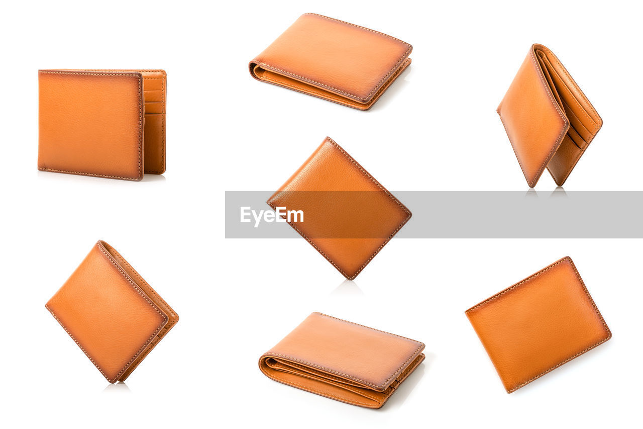 HIGH ANGLE VIEW OF ORANGE PENCILS ON WHITE BACKGROUND
