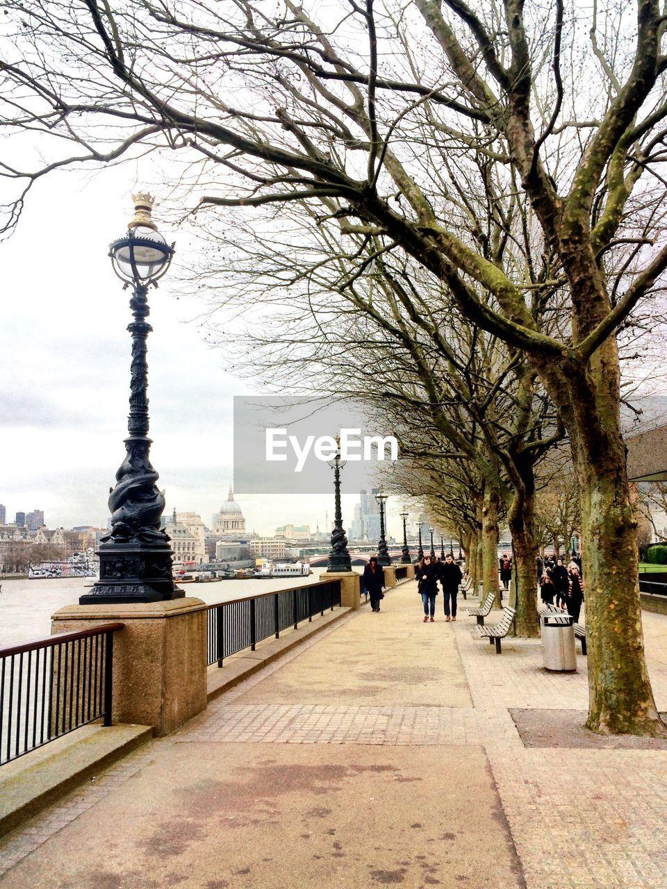 TOURISTS WALKING ON RIVERBANK