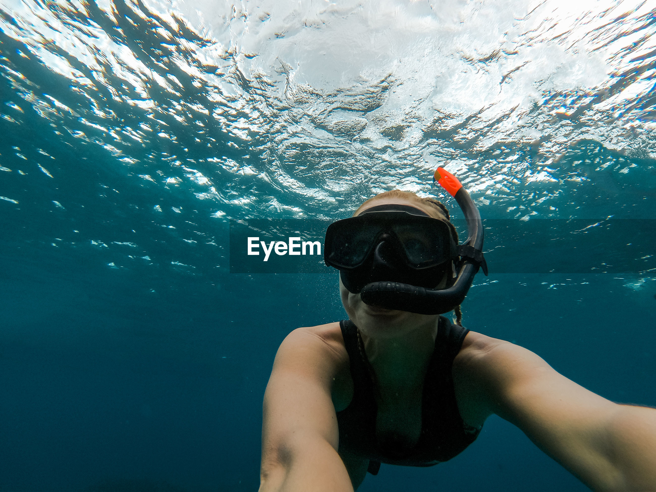 Close-up of woman snorkeling in sea