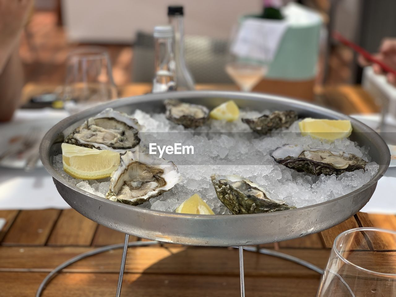 food and drink, food, table, freshness, indoors, seafood, healthy eating, close-up, focus on foreground, still life, incidental people, restaurant, ready-to-eat, wellbeing, fish, household equipment, serving size, vertebrate, animal, ice