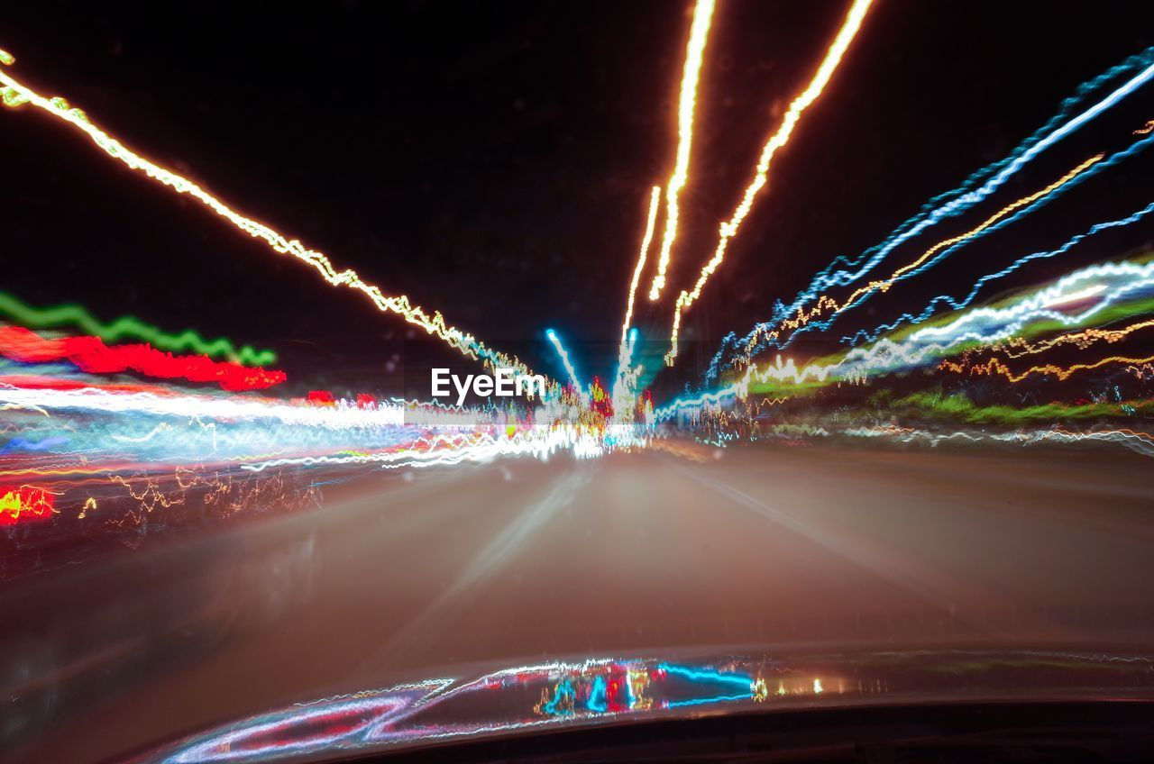 illuminated, light trail, night, long exposure, speed, transportation, glowing, car, road, motion, land vehicle, multi colored, no people, outdoors, sky, city
