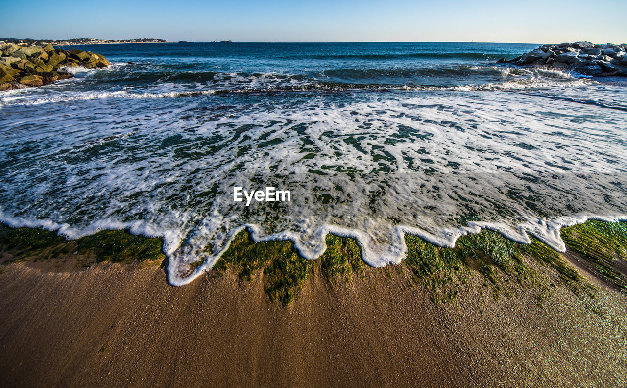 sea, water, beach, land, beauty in nature, wave, horizon over water, aquatic sport, scenics - nature, surfing, motion, horizon, sky, sport, nature, day, tranquil scene, sand, outdoors, breaking