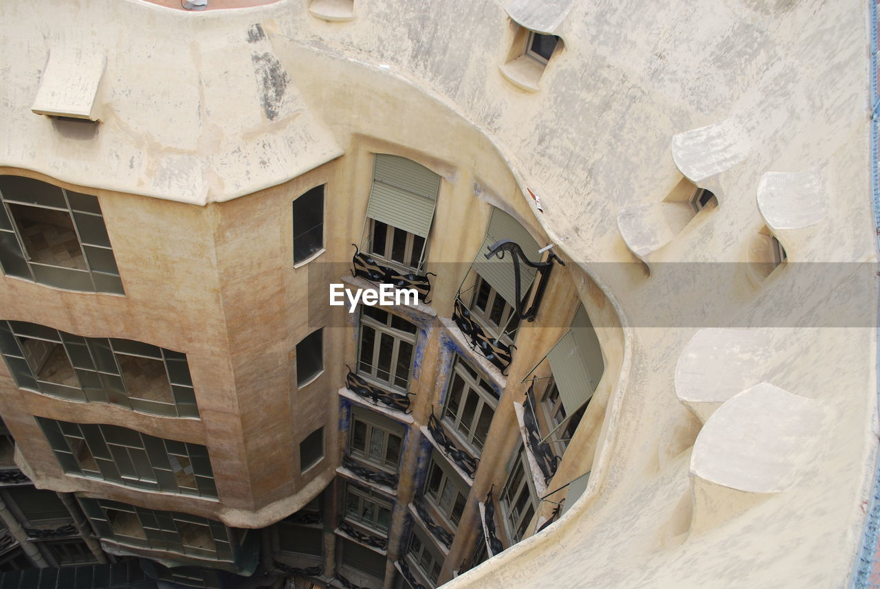 architecture, building exterior, window, built structure, balcony, low angle view, no people, outdoors, whitewashed, day
