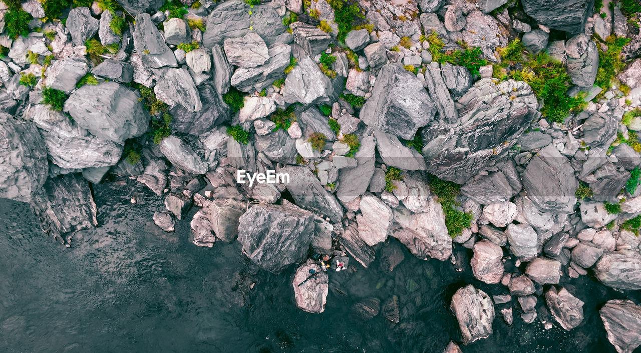 Close-Up Of Rocks On Coast