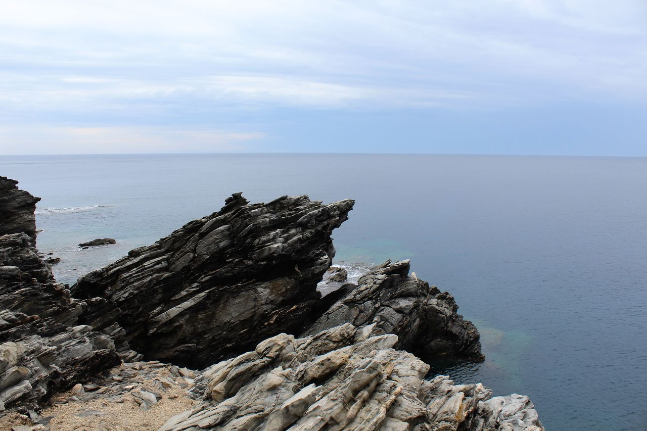 sea, sky, water, beauty in nature, scenics - nature, horizon, tranquil scene, rock, tranquility, horizon over water, rock - object, solid, rock formation, nature, no people, cloud - sky, idyllic, non-urban scene, day, outdoors, rocky coastline, eroded
