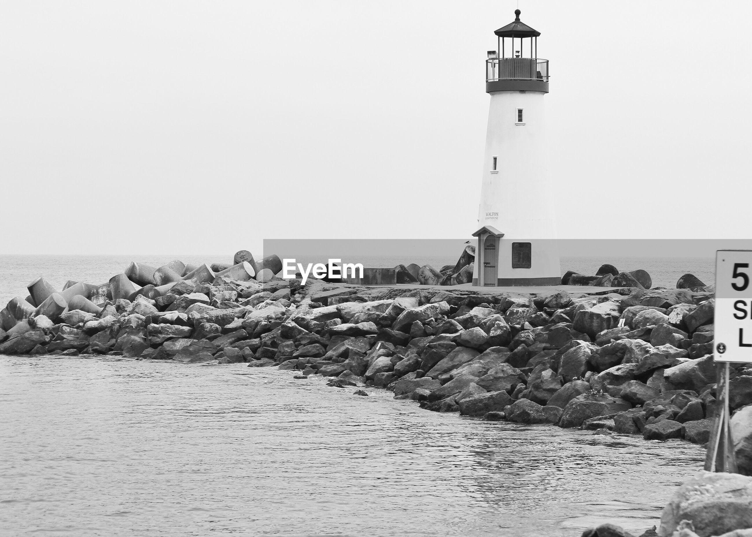 Lighthouse on stone jetty