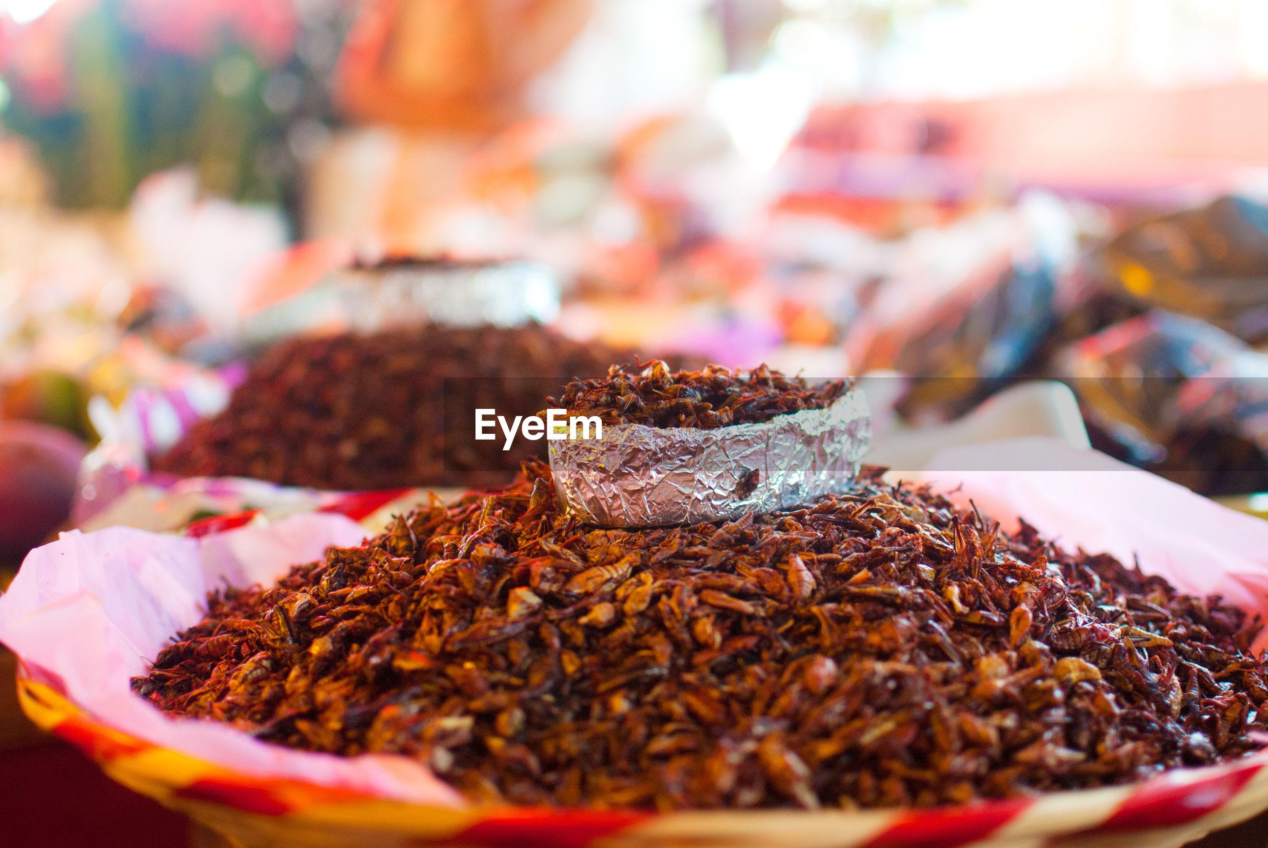 Close-up of chapulines at market stall