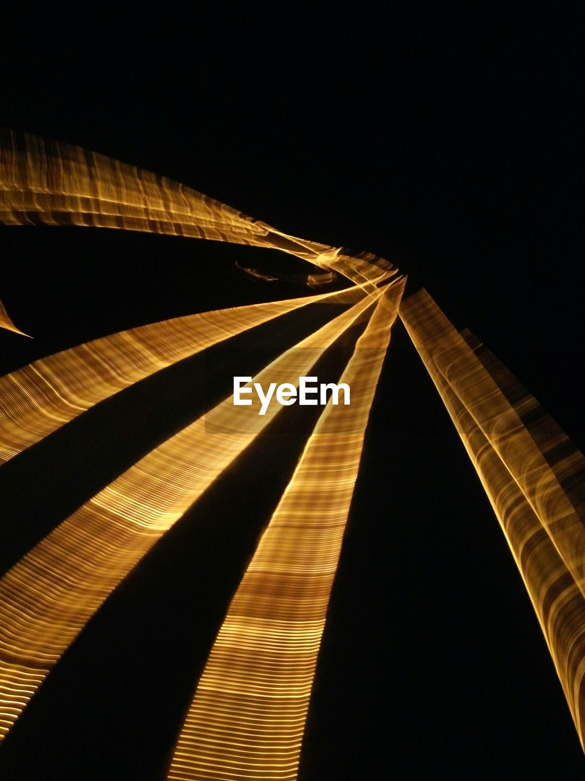 Blurred motion of illuminated pyramid at night