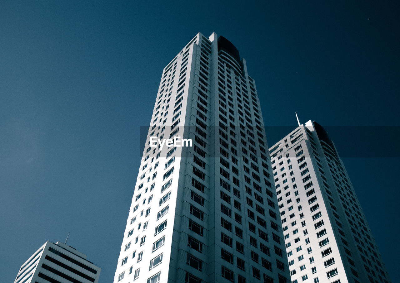 architecture, modern, skyscraper, building exterior, built structure, low angle view, city, clear sky, window, day, no people, sky, outdoors, cityscape