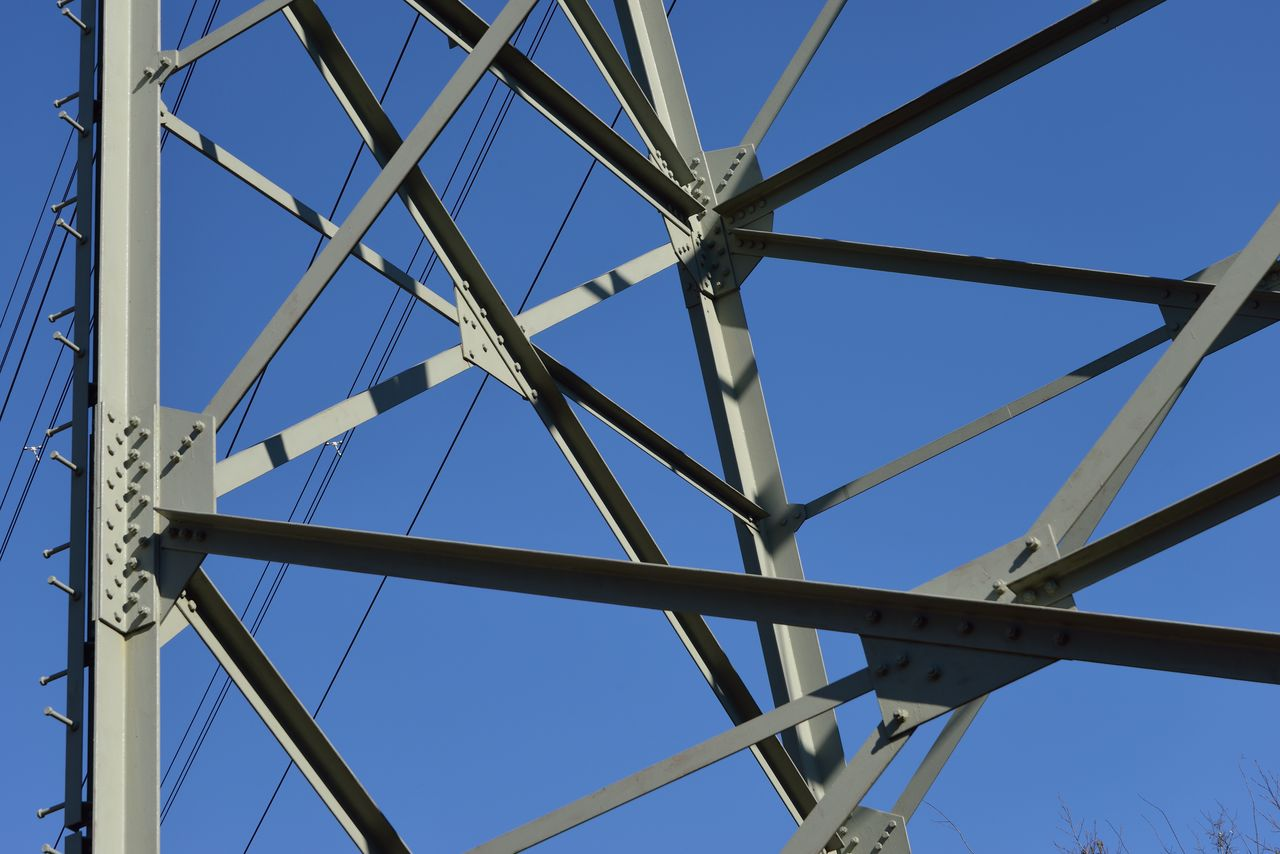 sky, low angle view, built structure, clear sky, architecture, metal, blue, connection, no people, nature, day, pattern, bridge, outdoors, bridge - man made structure, sunlight, full frame, technology, transportation, power supply, directly below, girder