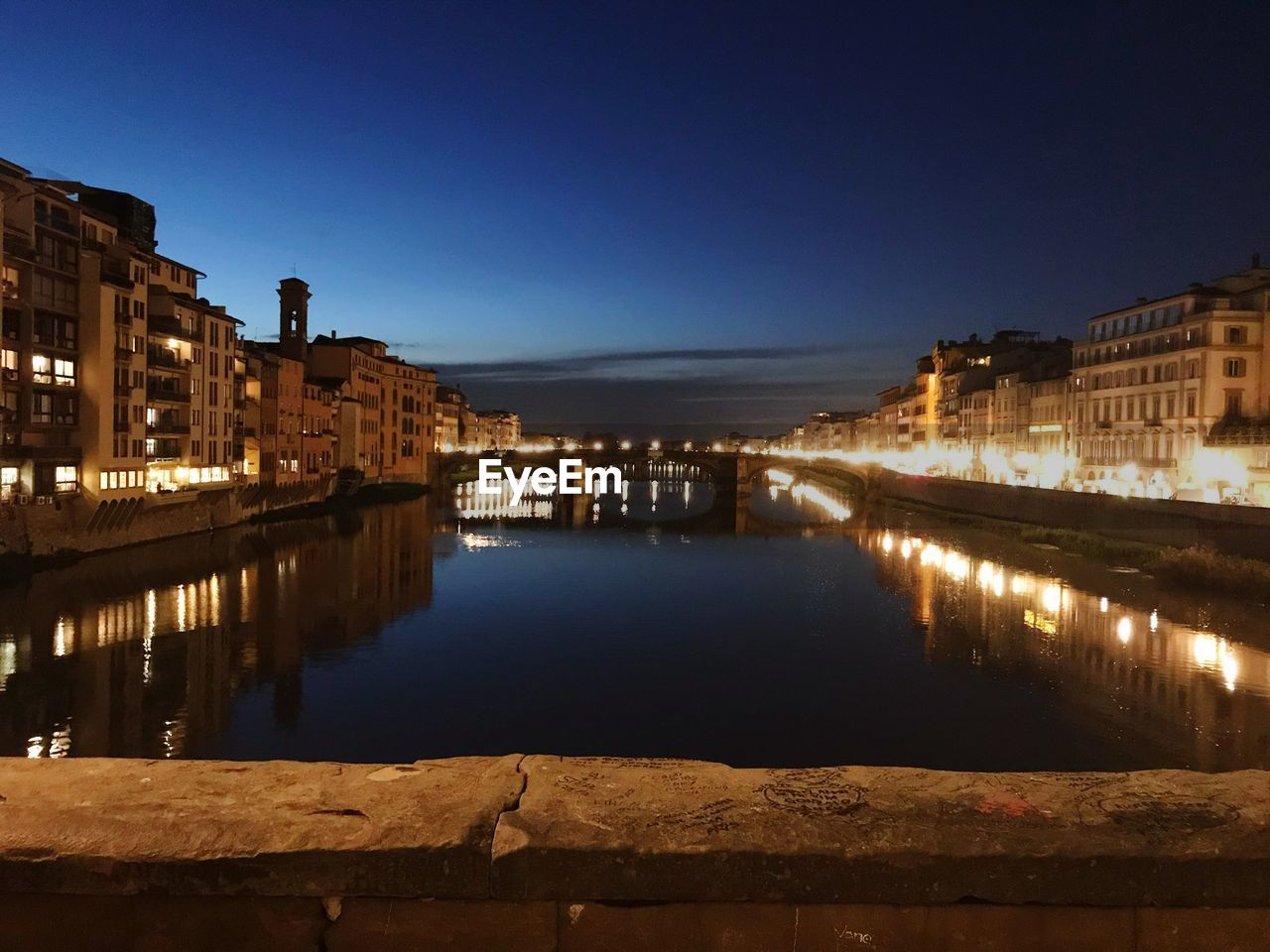 architecture, built structure, illuminated, building exterior, reflection, night, water, outdoors, sky, travel destinations, river, no people, city, blue, chain bridge