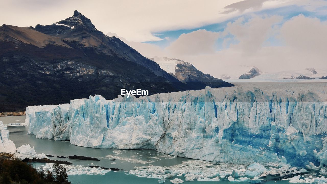 Scenic View Of Ice And Mountains Against Sky