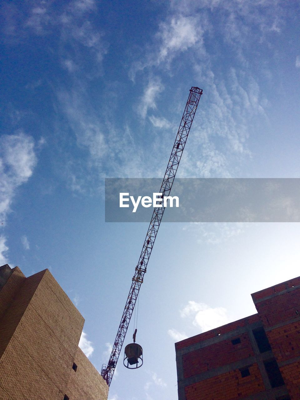 architecture, low angle view, built structure, development, sky, building exterior, construction site, cloud - sky, no people, outdoors, day