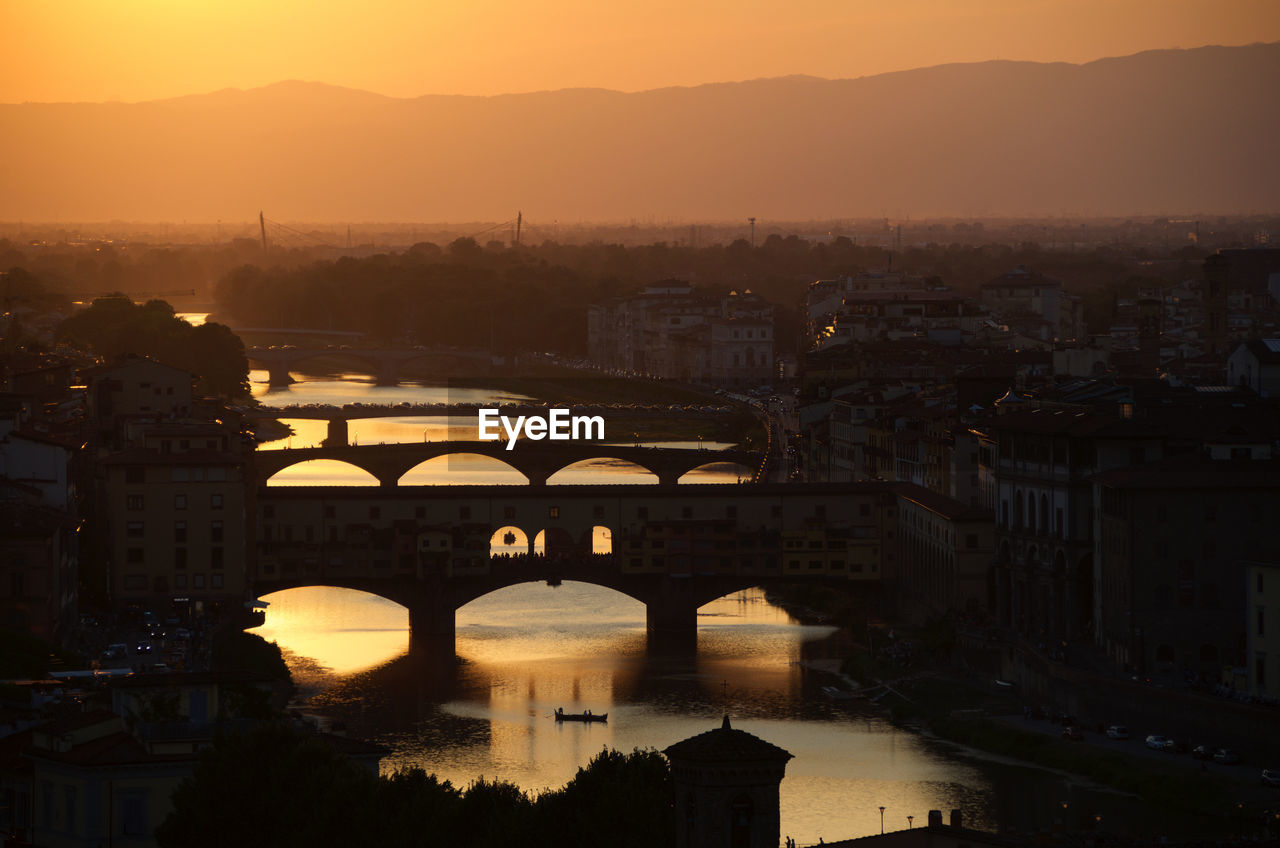 High Angle View Of Bridges Over River In City During Sunset
