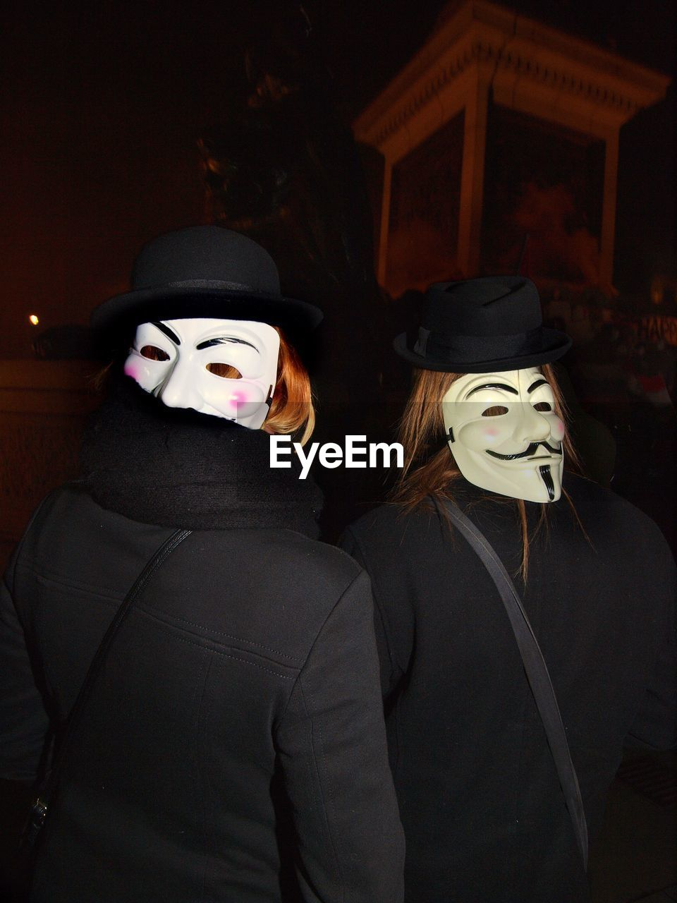 mask - disguise, costume, halloween, night, celebration, disguise, spooky, two people, holiday - event, carnival, real people, men, women, stage costume, togetherness, indoors, witch, people