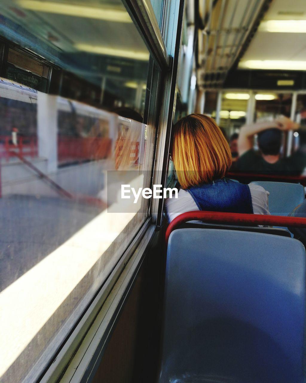 Rear view of woman in train